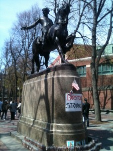 Paul Revere statue with a memorial for the Boston Marathon victims - religious images for the deceased and a candle for every person injured.