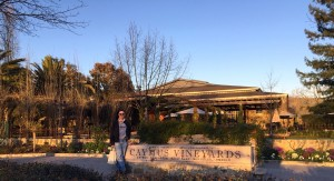 Tim in front of Caymus Vineyards' sign