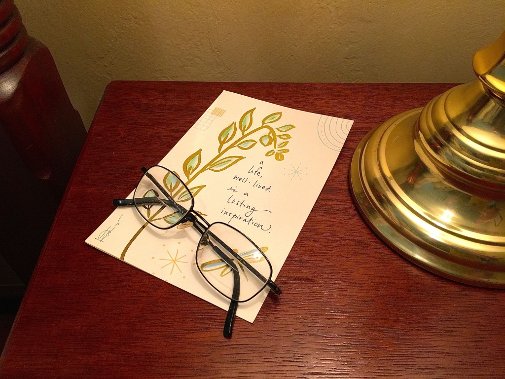 Daddy's reading glasses sit on the card Tim gave me when I got home.